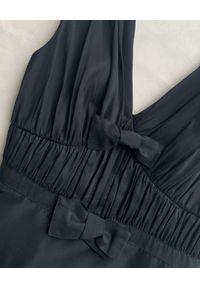 SELF PORTRAIT - Czarna sukienka midi z kokardami. Typ kołnierza: kokarda. Kolor: czarny. Materiał: bawełna. Typ sukienki: rozkloszowane, dopasowane. Styl: elegancki. Długość: midi