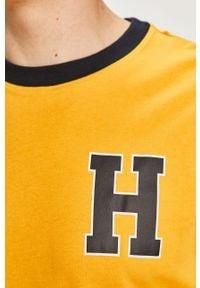 Żółty t-shirt TOMMY HILFIGER na co dzień, z nadrukiem, casualowy