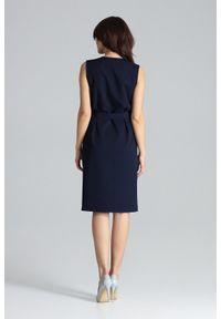 Lenitif - Elegancka ołówkowa kopertowa sukienka kimonowa granatowa. Okazja: do pracy. Typ kołnierza: dekolt kopertowy. Kolor: niebieski. Typ sukienki: kopertowe, ołówkowe. Styl: elegancki