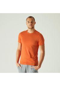 NYAMBA - Koszulka fitness slim. Kolor: pomarańczowy. Materiał: poliester, elastan, bawełna, materiał. Długość rękawa: krótki rękaw. Długość: krótkie. Sport: fitness