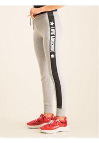 Love Moschino - LOVE MOSCHINO Spodnie dresowe W142413M4068 Regular Fit. Kolor: szary. Materiał: dresówka