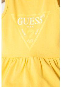 Żółta sukienka Guess z nadrukiem, rozkloszowana