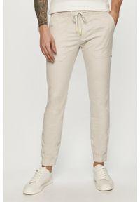Tommy Jeans - Spodnie. Kolor: szary. Materiał: bawełna