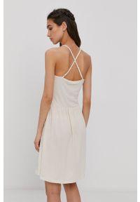 Vero Moda - Sukienka. Kolor: beżowy. Materiał: dzianina, bawełna. Długość rękawa: na ramiączkach. Wzór: gładki. Typ sukienki: rozkloszowane