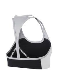 Biustonosz sportowy damski Nike CJ5865. Materiał: skóra, materiał. Rodzaj stanika: wyciągane miseczki. Technologia: Dri-Fit (Nike). Sport: wspinaczka, fitness