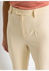 Spodnie bonprix waniliowy. Kolor: żółty. Styl: klasyczny