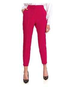 TOP SECRET - Spodnie damskie w intensywnym kolorze. Stan: podwyższony. Kolor: różowy. Materiał: tkanina. Wzór: gładki. Sezon: jesień. Styl: klasyczny, elegancki