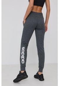 Adidas - adidas - Spodnie. Kolor: szary. Materiał: bawełna