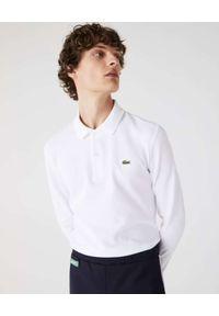Lacoste - LACOSTE - Biała koszulka polo z długim rękawem Slim Fit. Typ kołnierza: polo. Kolor: biały. Materiał: bawełna, prążkowany. Długość rękawa: długi rękaw. Długość: długie. Styl: klasyczny