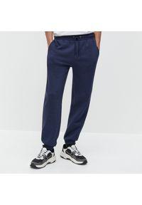 Niebieskie spodnie Reserved melanż
