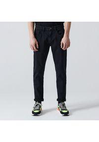 Czarne jeansy Cropp