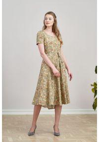 Marie Zélie - Sukienka Rosa Anemone beżowa. Typ kołnierza: kokarda. Kolor: beżowy. Materiał: bawełna, wiskoza, skóra, materiał. Długość rękawa: krótki rękaw. Długość: midi