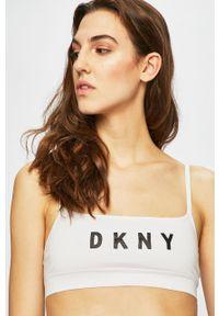 Biały biustonosz sportowy DKNY z nadrukiem