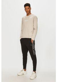 Czarne spodnie dresowe Calvin Klein Performance z aplikacjami