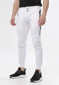 Białe spodnie dresowe Born2be