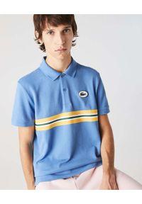 Lacoste - LACOSTE - Niebieska koszulka polo z paskami Regular Fit. Typ kołnierza: polo. Kolor: niebieski. Materiał: bawełna. Wzór: kolorowy. Styl: retro