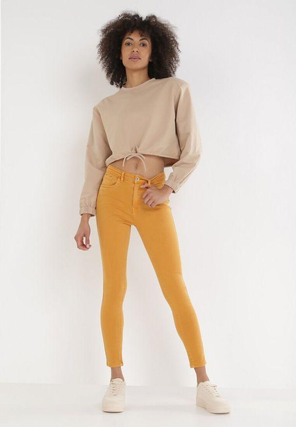 Żółte jeansy Born2be