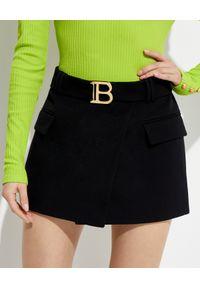 Balmain - BALMAIN - Wełniana spódnica z paskiem. Kolor: czarny. Materiał: wełna