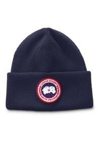 CANADA GOOSE - Granatowa czapka z logo. Kolor: niebieski. Materiał: wełna, materiał. Sezon: zima