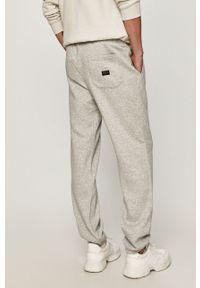 Szare spodnie dresowe Quiksilver z nadrukiem