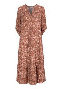 Cellbes Wzorzysta sukienka z falbanami rdzawy we wzory female brązowy/pomarańczowy/ze wzorem 46/48. Typ kołnierza: dekolt w serek. Kolor: pomarańczowy, brązowy, wielokolorowy