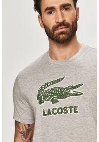 Szary t-shirt Lacoste na co dzień, z aplikacjami, casualowy