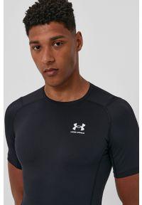 Under Armour - T-shirt. Okazja: na co dzień. Kolor: czarny. Materiał: dzianina. Styl: casual