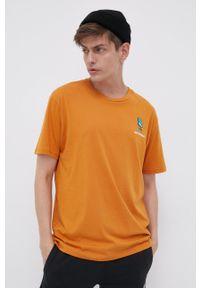 New Balance - T-shirt bawełniany. Kolor: pomarańczowy. Materiał: bawełna. Wzór: aplikacja