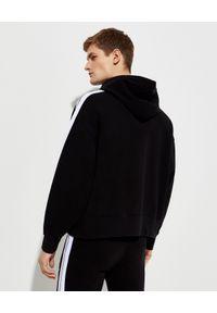 PALM ANGELS - Czarna bluza z kapturem. Typ kołnierza: kaptur. Kolor: czarny. Materiał: bawełna. Długość rękawa: długi rękaw. Długość: długie. Wzór: aplikacja, nadruk