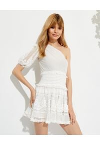 ROCOCO SAND - Asymetryczna sukienka mini Ame. Kolor: biały. Materiał: wiskoza, koronka, materiał. Wzór: aplikacja, kropki, koronka. Typ sukienki: asymetryczne. Długość: mini