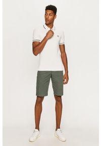 Calvin Klein Jeans - Polo. Okazja: na co dzień. Typ kołnierza: polo. Kolor: biały. Długość: krótkie. Styl: casual