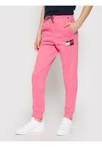TOMMY HILFIGER - Tommy Hilfiger Spodnie dresowe Flag Print KG0KG05769 D Różowy Regular Fit. Kolor: różowy. Materiał: dresówka. Wzór: nadruk