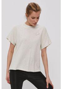 Nike Sportswear - T-shirt. Okazja: na co dzień. Kolor: beżowy. Materiał: włókno, bawełna. Wzór: aplikacja. Styl: sportowy, casual