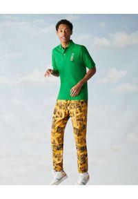 Lacoste - LACOSTE - Zielona koszulka polo z logoRegular Fit. Typ kołnierza: polo. Kolor: zielony. Materiał: bawełna. Wzór: haft, prążki. Styl: sportowy