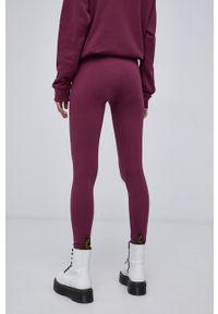 adidas Originals - Legginsy. Stan: podwyższony. Kolor: fioletowy. Materiał: dzianina. Wzór: gładki