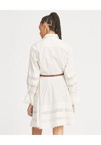 Ralph Lauren - RALPH LAUREN - Biała sukienka z koronką. Typ kołnierza: polo. Kolor: biały. Materiał: koronka. Długość rękawa: długi rękaw. Wzór: koronka. Długość: mini
