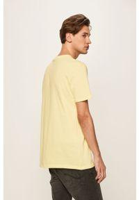 Żółty t-shirt Quiksilver z okrągłym kołnierzem, na co dzień