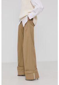 Victoria Victoria Beckham - Spodnie. Stan: podwyższony. Kolor: beżowy. Materiał: tkanina