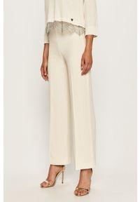 Kremowe spodnie materiałowe TwinSet z podwyższonym stanem