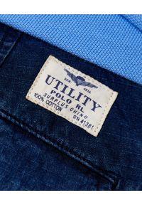 Ralph Lauren - RALPH LAUREN - Niebieskie szorty Cargo. Kolor: niebieski. Materiał: tkanina. Wzór: aplikacja, moro, paski, napisy. Styl: militarny, klasyczny