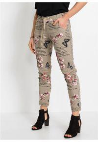 Spodnie Loose Fit bonprix khaki. Kolor: szary. Wzór: nadruk