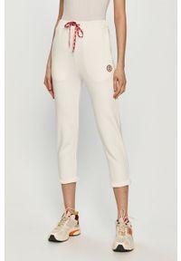 Białe spodnie dresowe Femi Stories gładkie