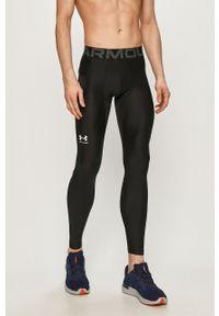 Czarne legginsy sportowe Under Armour z nadrukiem
