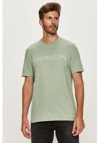 Calvin Klein - T-shirt. Okazja: na co dzień. Kolor: turkusowy. Wzór: nadruk. Styl: casual