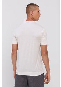 Emporio Armani - T-shirt. Kolor: biały. Materiał: dzianina. Wzór: aplikacja