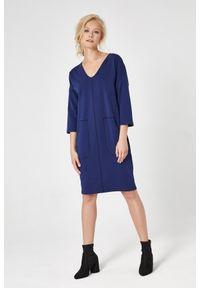 e-margeritka - Sukienka dresowa trapezowa granatowa - m. Okazja: na co dzień. Kolor: niebieski. Materiał: dresówka. Typ sukienki: trapezowe. Styl: casual