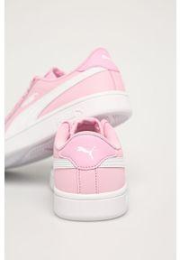 Różowe buty sportowe Puma z cholewką, na sznurówki