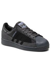 Adidas - Buty adidas - Superstar FX5564 Cblack/Cblack/Duspur. Zapięcie: pasek. Kolor: czarny. Materiał: skóra, materiał, zamsz. Szerokość cholewki: normalna. Wzór: paski. Model: Adidas Superstar. Sport: skateboard