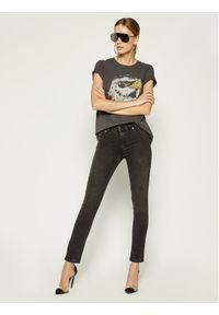 Diesel Jeansy 00STRN069FW Czarny Slim Fit. Kolor: czarny. Materiał: elastan, poliester, bawełna, jeans