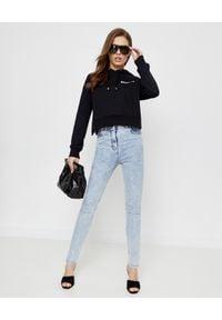 Balmain - BALMAIN - Wąskie jeansy skinny fit. Stan: podwyższony. Kolor: niebieski. Wzór: aplikacja. Styl: klasyczny, sportowy